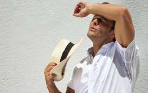 how-to-stop-sweating-in-the-summer-heat-sun-sweat-men-health-body-man-e1485966375156